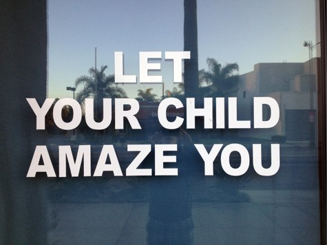"sign in a tutoring service window that says ""LET YOUR CHILD AMAZE YOU"""