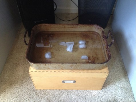an improvised ice bath under a desk