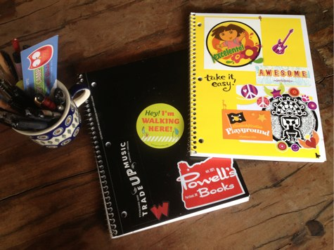 spiral notebooks plastered with stickers