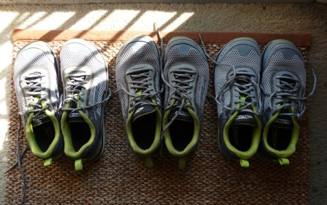three pairs of identical walking shoes